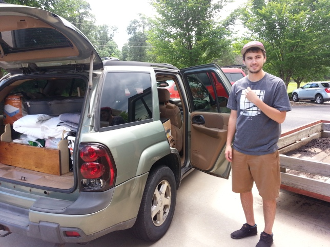 Travis and the packed car